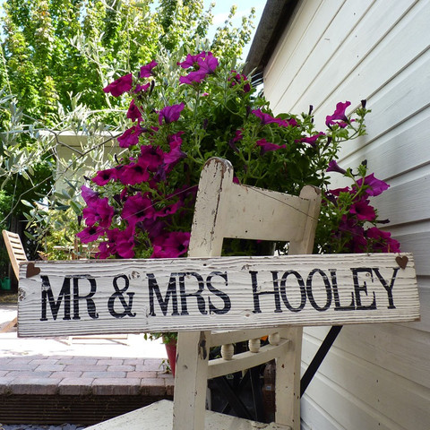 antiqued sign with flowers